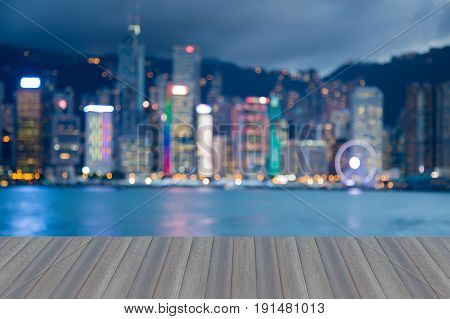 Opening wooden floor Blurred bokeh light night view Hong Kong business downtown abstract background