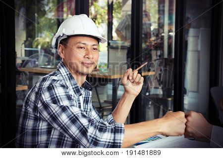 One engineer is working in cafe with his partner
