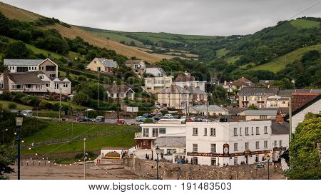 Ilfracombe UK - July 27 2016: view of village and Fo'c's'le Inn Hotel from Combe Martin beach in Ilfracombe Devon England