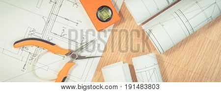 Electrical Blueprints Or Diagrams And Orange Work Tools For Use In Engineer Jobs