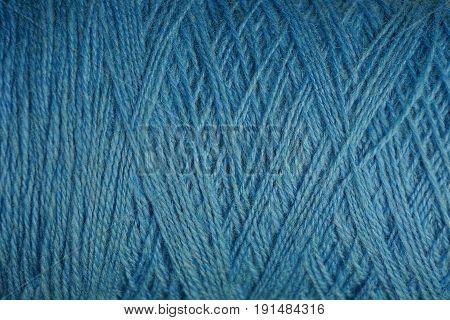 Blue texture of a hank of thick woolen threads