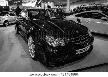 STUTTGART GERMANY - MARCH 02 2017: Mid-size luxury sports car Mercedes-Benz CLK63 AMG Black Series 2007. Black and white. Europe's greatest classic car exhibition