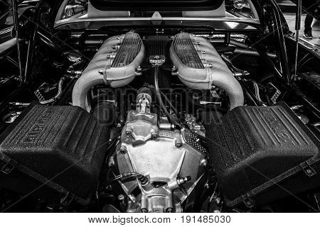 STUTTGART GERMANY - MARCH 02 2017: Engine compartment of a sports car Ferrari 512 TR 1994. Black and white. Europe's greatest classic car exhibition