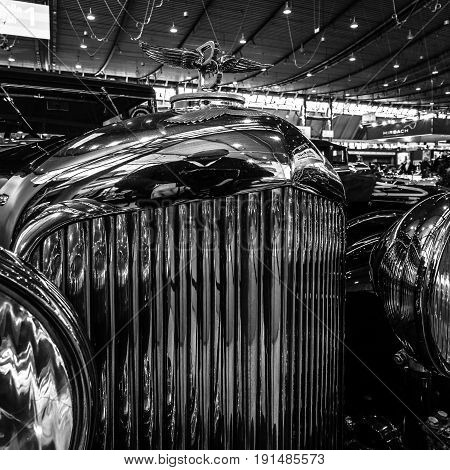 STUTTGART GERMANY - MARCH 02 2017: Hood ornament of a luxury car Bentley 4-Litre 1931. Black and white. Europe's greatest classic car exhibition