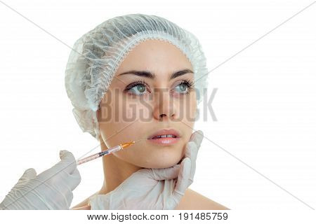 a close-up portrait of the lovely girls in a special cap on admission to a doctor isolated on white background