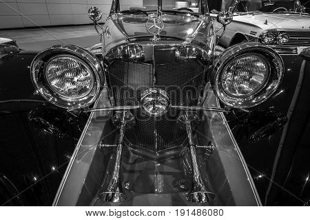 STUTTGART GERMANY - MARCH 02 2017: Detail of the luxury car Mercedes-Benz 500 Cabrio Replica 1934. Black and white. Europe's greatest classic car exhibition