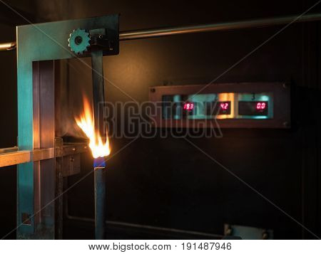 vertical burning test in second stage of physical property of polymer substance in standard laboratory or flamability of materials to classified of V0 V1 or V2.