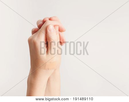 Sticking Plaster On Hand On White Background