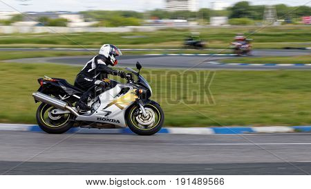 A Motorcycle Racers Takes A Practice Run On A Sports Track