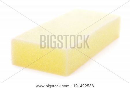 yellow household sponge on a white background