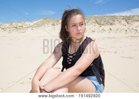 a lovely teenager girl in summer beach
