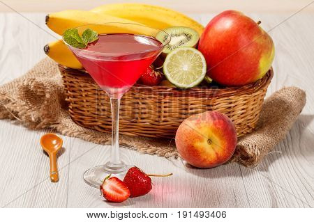 Cherry Jelly In The Glass, Fresh Strawberries, Nectarine, Lime, Kiwi, Banana, Apple In A Wicker Bask