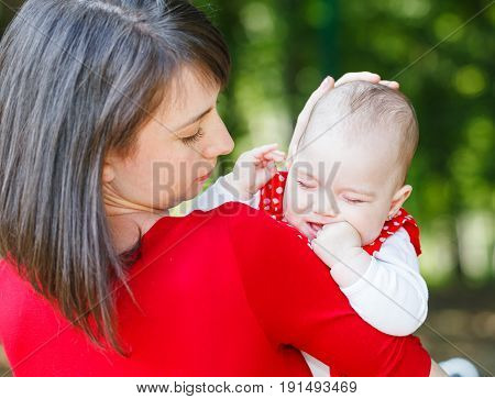 Photo of adorable baby girl with her mother