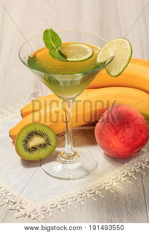Kiwi Jelly With Lime Pieces In The Glass Topped Mint Leaves And Fruits On The White Napkin