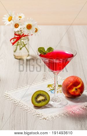 Cherry Jelly In The Glass Topped Mint Leaves And Bouquet Of Chamomiles On The Background