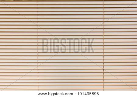 Venetian blinds background.Sunlight coming through venetian blinds by the window