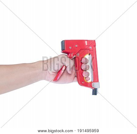 Man's hand with a red stapler isolated on white