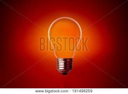 Empty Light Bulb On A Red Background