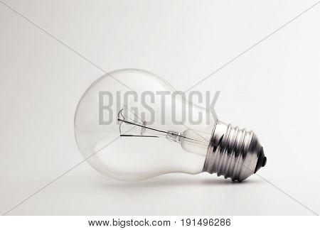 Transparent Light Bulb On A White Background.