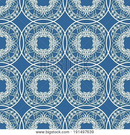 Fine blue geometric lace patterns on blue background. Seamless patterns in ethno style.