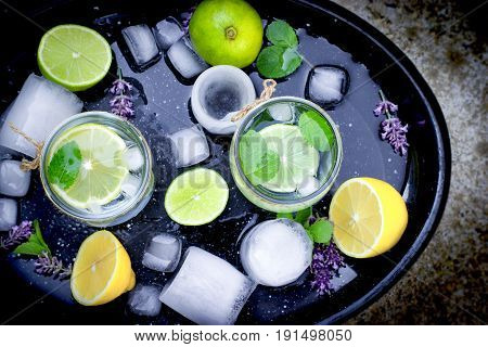 Healthy drink, mineral water with lemon and ice - cold fresh drink, healthy lemon juice