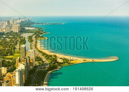 Chicago lakeside aerial view toned image. Vintage coloured photo of buildings and highway next to the lake Michigan. Photo from helicopter in Chicago. Summer and travel concepts