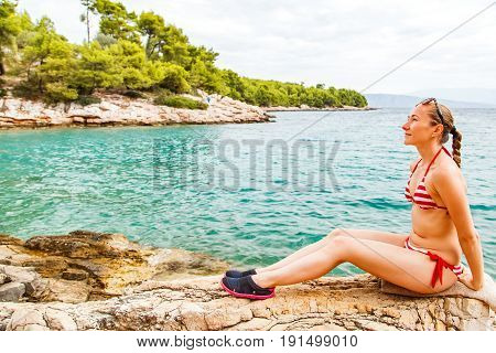 Woman in swimsuit standing on the beach