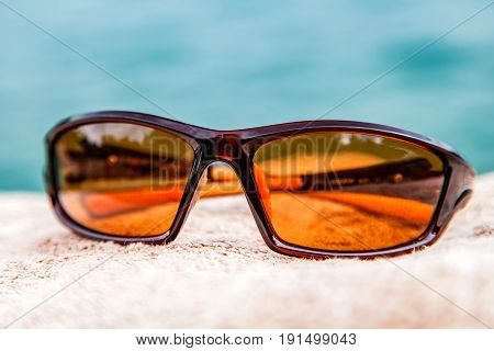 Close up photo of brown male sunglass