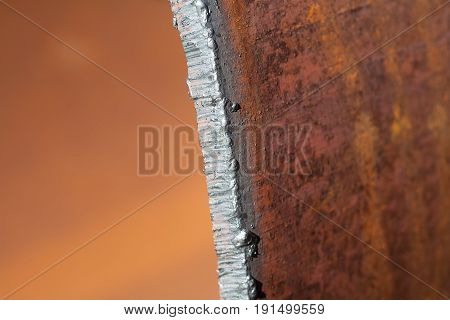 Repair of water pipes. Removal of the damaged area. In the frame the pipe cut after welding. Colors are brown green gray silver white