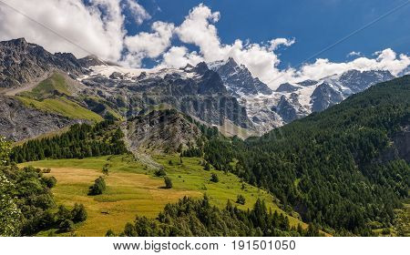 Summer view of the mountains and glaciers of the Ecrins National Park (Bec de L'Homme La Meije Glacier du Tabuchet) from the village of La Grave. Hautes-Alpes PACA Region Southern French Alps France