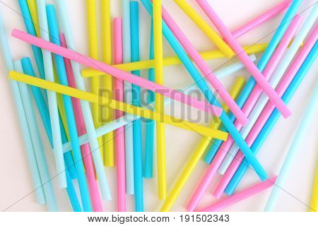 bright colored straws for drinks on a white background
