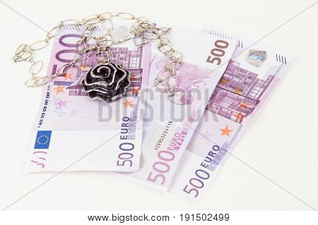 500 Euro bank notes and jewelry. Concept of consumerism and money spending