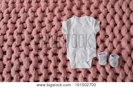 Baby Clothes And Shoes For Newborn In Pastel Colors On Pink Merino Wool Blanket. Set Of Baby Clothes