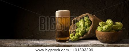 Still life with a keg of beer and hops