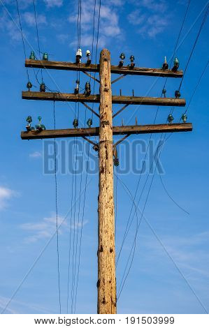A Old wooden pole for telecommunication .
