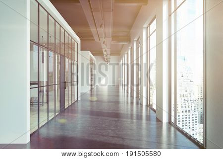 Front view of an office lobby with glass and white walls white and black concrete floor and pipes near the ceiling. 3d rendering mock up toned image