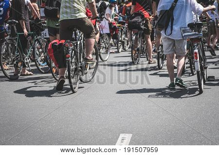 Many People On Bicycles On On Street From Behind -