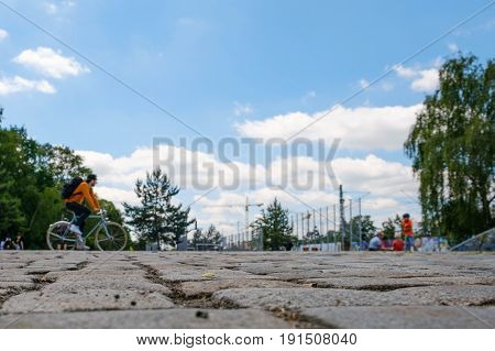Cobble Stone Closeup With People In Park And Blue Sky Background
