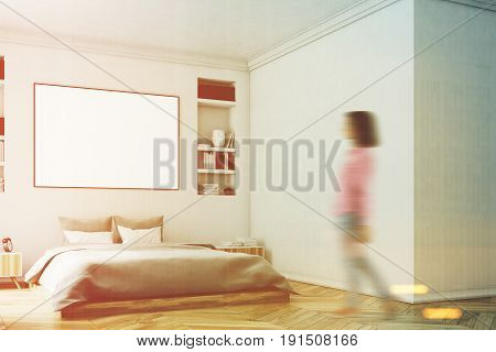 Woman in a corner of a modern luxury bedroom with white walls a large bed in the center of the room a bookcase a large window and a framed horizontal poster. 3d rendering mock up toned image