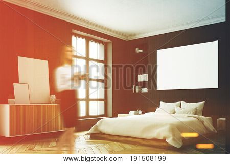 Blond woman in a corner of a modern luxury bedroom with black walls a large bed in the center of the room a bookcase a large window and a framed horizontal poster. 3d rendering mock up toned image