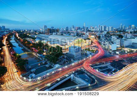 Cityscape of Bangkok viewing Bangkok train station or Hua Lamphong Railway Station in blue hour
