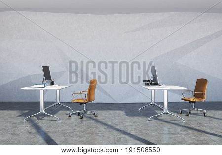 Modern office interior with concrete walls and floor white computer tables and brown chairs standing near them. 3d rendering mock up