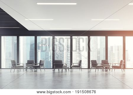 Waiting room room of a modern office with panoramic windows with dark wooden frames and gray comfortable armchairs standing in threes. 3d rendering mock up toned image