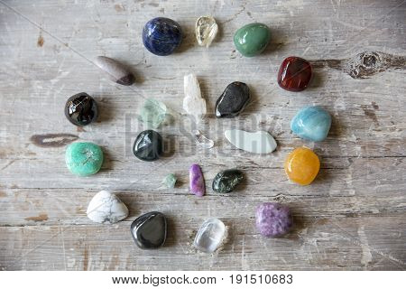 crystals in a circle on a wooden board