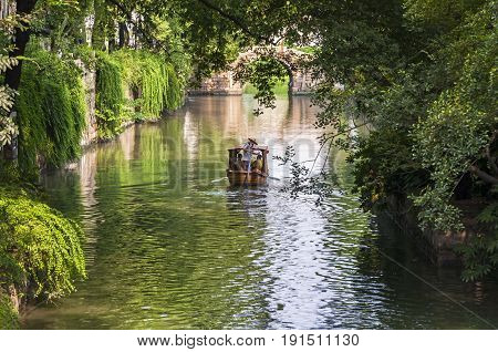 Suzhou, China - August 08, 2011: View of a canal in Tiger Hill Park. This park is a popular tourist destination and is known for its natural beauty as well as historical sites