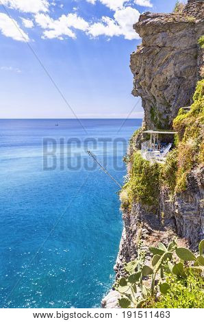 A cliff with balcony overlook the ligurian sea, at the world famous Cinque Terre, Italy