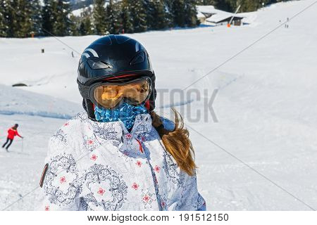 Close up photo of young woman on ski holiday in the mountains