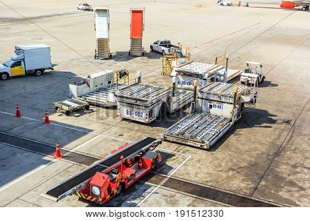 Airplane tow truck and ladder near Aircraft on the runway in airport.