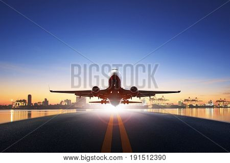 cargo plane take off from airport runways against ship port background use for air transportation and cargo logistic industry import export business