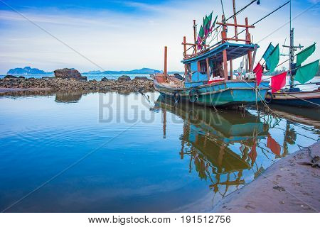 Long Tail Boat And Reflex In Water On Sea Water Near Seascape